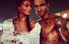 Why Are Adam Levine And His Wife Behati Prinsloo Dripping With Blood?